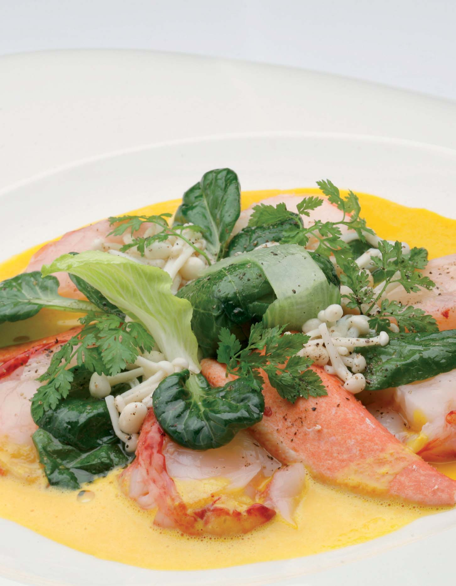 Medallions of Atlantic lobster with Pak Choi, Hierbas de Mallorca and Saffron Stock and Enoki mushrooms - Recipes - Gastronomy - Balearic Islands - Agrifoodstuffs, designations of origin and Balearic gastronomy